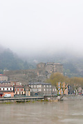 The town Tournon across the Rhone river with the Chateau de Tournon. under snow in seasonably exceptional weather in April 2005. Tain l'Hermitage, Drome, Drôme, France, Europe