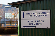 A sign showing the direction to Woolwich crown court & HMP Belmarh.