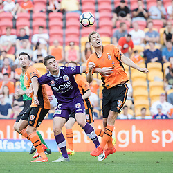 BRISBANE, AUSTRALIA - OCTOBER 30: Thomas Kristensen of the roar and Brandon Wilson of the Glory compete for the ball during the round 4 Hyundai A-League match between the Brisbane Roar and Perth Glory at Suncorp Stadium on October 30, 2016 in Brisbane, Australia. (Photo by Patrick Kearney/Brisbane Roar)