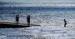 Children playing in the sea off Whitstable, Kent England<br /> <br /> (c) Andrew Wilson | Edinburgh Elite media