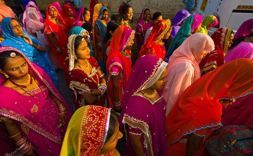Women and girls walking in a wedding procession, Udaipur, Rajasthan, India