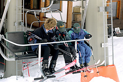 THE PRINCESS OF WALES AND HER SONS<br /> PRINCE WILLIAM AND PRINCE HARRY [R]<br /> HIDE FROM PHOTOGRAPHERS AS THEY TAKE<br /> THE FIRST CHAIR LIFT ON THE SECOND DAY<br /> OF THEIR HOLIDAY IN LECH, AUSTRIA.