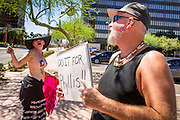 26 MARCH 2012 - PHOENIX, AZ: CHRISTI, left, talks to BILL BOYLE, a comedy writer, during a topless protest march in Phoenix. About 40 people marched through central Phoenix Sunday to call for a constitutional amendment to give women the same right to go shirtless in public that men have. The Phoenix demonstration was a part of a national Topless Day of Protest. Phoenix prohibits women from going topless in public so protesters, women and men, covered their nipples and areolas with tape. The men did it to show solidarity with the women marchers.    PHOTO BY JACK KURTZ