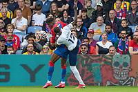 Football - 2021/2022  Premier League - Crystal Palace vs Tottenham Hotspur - Selhurst Park  - Saturday 11th September 2021.<br /> <br /> Emerson (Tottenham Hotspur) gets his leg around Wilfried Zaha (Crystal Palace) in an attemt to reach the ball at Selhurst Park.<br /> <br /> COLORSPORT/DANIEL BEARHAM