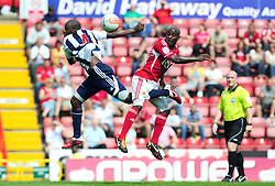 Bristol City's Jamal Campbell-Ryce battles for the high ball with West Bromwich Albion's Youssouf Mulumbu   - Photo mandatory by-line: Joseph Meredith / JMPUK - 30/07/2011 - SPORT - FOOTBALL - Championship - Bristol City v West Bromwich Albion - Ashton Gate Stadium, Bristol, England