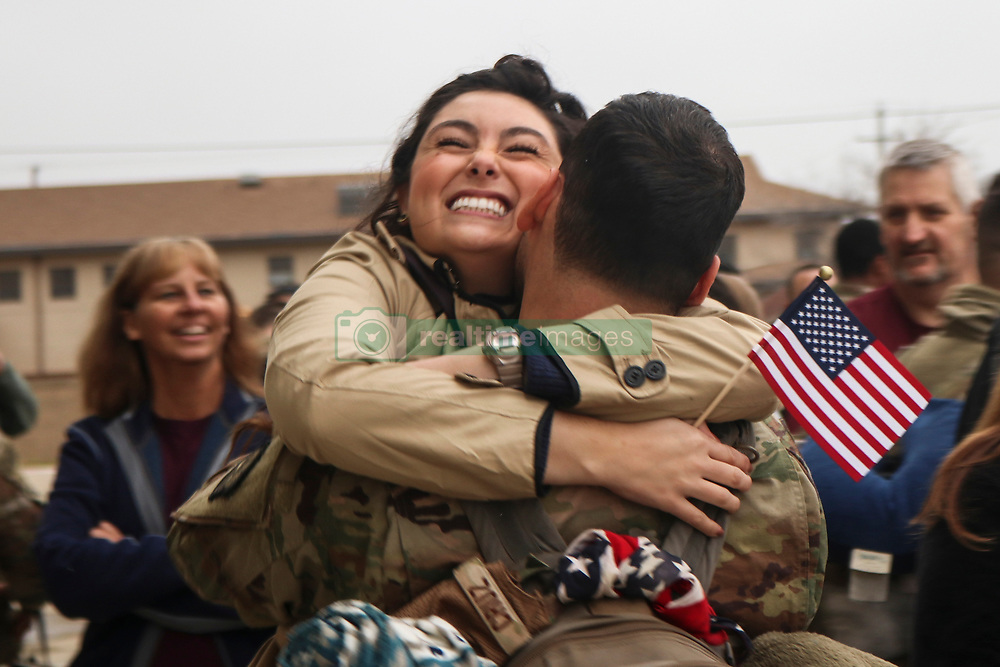 Madison Cruz hugs her husband, Senior Airman Luis Cruz, 9th Aircraft Maintenance Squadron crew chief, after he returned from a deployment to Al Udeid, Qatar, at Dyess Air Force Base, Texas, March 11, 2019. Once the service members arrived at Dyess, they were welcomed home with open arms from family members, friends and members of the Abilene community. (U.S. Air Force photo by Staff Sgt. David Owsianka)