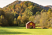 An old wooden barn in a farm field with a Quilt Block on the Quilt Trails in Prices Creek, North Carolina.