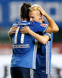 ZHUHAI, July 19, 2017 Luke Hemmerich (R) of FC Schalke 04 celebrates scoring with his teammate Yevhen Konoplyanka during a pre-season soccer match between Bundesliga's FC Schalke 04 and Turkish Super League champion Besiktas JK at Zhuhai Sports Center Stadium in Zhuhai, south China's Guangdong Province, July 19, 2017. FC Schalke 04 won 3-2. (Credit Image: © Wang Lili/Xinhua via ZUMA Wire)