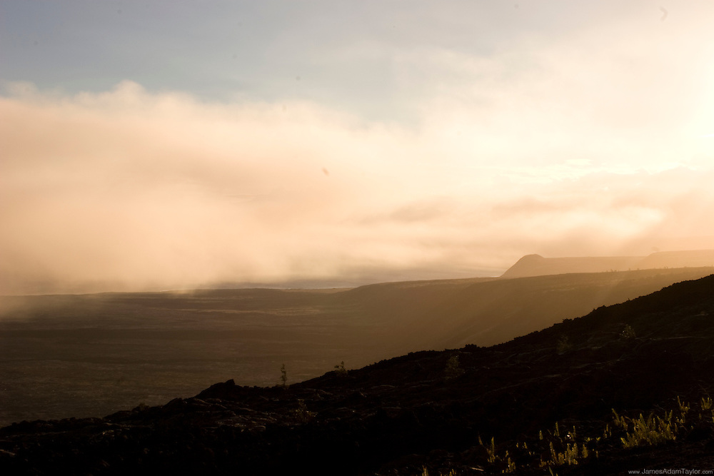 As the sun sets, the winds change and the area is engulfed in noxious vog, Chain of Craters rd, Volcanoes National Park, Hawaii.