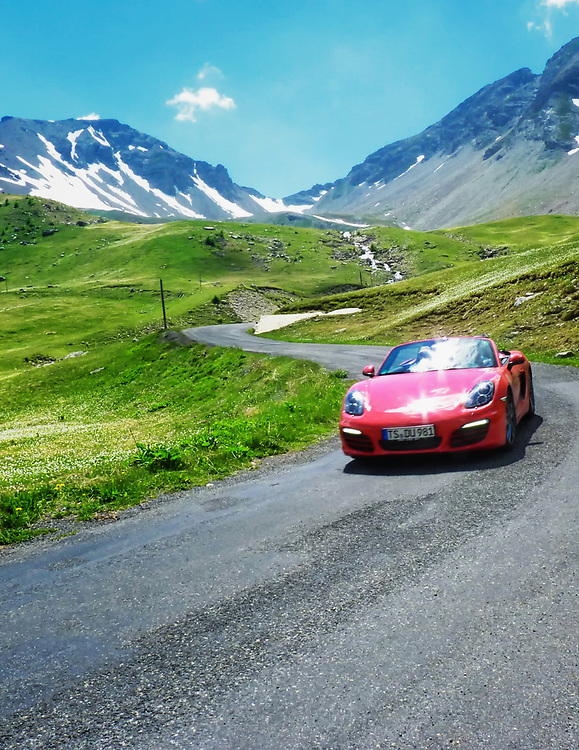 This red Porsche Boxster was caught enjoying a pass road in the French Alps.  This is the Col de la Cayolle on the Route des Grandes Alpes.