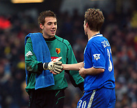 On loan from Chelsea, Lenny Pidgeley (Watford's goalkeeper) shakes hands with Jesper Gronkjaer (Chelsea) at the end of the match. Watford v Chelsea, Vicarage Road, 03/01/2004, F.A. Cup, 3rd Round. Credit : Colorsport / Robin Hume. Digital File Only.