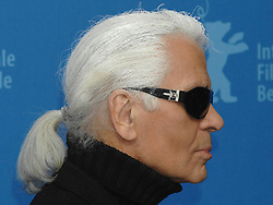 German Designer, Photographer and Director Karl Lagerfeld poses for photographers and takes pictures of them during a photo-call for the movie 'Lagerfeld Confidential' at the 57th International Film Festival Berlinale in Berlin, Germany, on February 10, 2007. Photo by Christophe Guibbaud/ABACAPRESS.COM