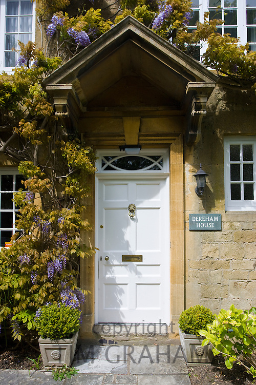Traditional period village house with porch and climbing shrub, Willersey in the Cotswolds, Worcestershire, UK