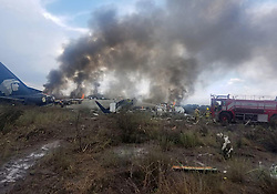 July 31, 2018 - Durango, Mexico - Rescuers work at the site where a plane crashed. An Aeromexico plane carrying more than 100 people crashed in the northern Mexican state of Durango on Tuesday, but there were no fatalities, authorities said. (Credit Image: © Especial/Xinhua via ZUMA Wire)