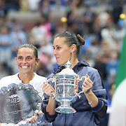 Winner Flavia Pennetta, (right), Italy, and Roberta Vinci, Italy, with their trophies after the Women's Singles Final match during the US Open Tennis Tournament, Flushing, New York, USA. 12th September 2015. Photo Tim Clayton