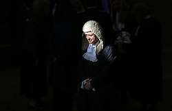 © Licensed to London News Pictures. 01/10/2015. London, UK. A judge is lit by a shaft of sunlight in Westminster Abbey as he takes part in the annual Judges Service. The Service heralds the start of the legal year in the United Kingdom. Photo credit: Peter Macdiarmid/LNP