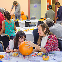 102514       Cable Hoover<br /> <br /> Katherine Belzowski, right, helps Monet Chavez clean out her pumpkin during a Big Brothers Big Sisters pumpkin carving event a the Hozho Center in Gallup Saturday.