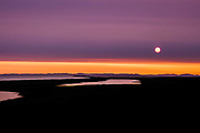 It was a hot smoky night on the northwest Arctic coast.  Fires were burning to the south where the trees still survive.  The sun does not set this time of the summer but skips across the horizon.  Making the hilly scenery even more breathtaking.  This is mid-August at about 1:00 am.