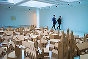 Contemporary installation exhibit 'Generation - The Lamp of Sacrifice, 286 Places of Worship in Edinburgh' by Nathan Coley, scaled hardboard cutouts on display in Gallery of Modern Art, GoMA, Glasgow, Scotland