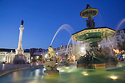 Water fountains at Rossio square in Lisbon. At the distance the National Theatre Maria II and the statue king Pedro IV, who also was the firts emperor of Brazil.