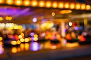 Blurred image of dodgem lights on Brighton pier in East Sussex, England