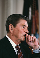 Reagan Reagan considers the answer to a question at a press conference in the East Room in April 1985.<br /> <br /> Photograph by Dennis Brack