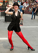 NYC, New York, U.S.  21st May 2013.  Wearing a dance costume in Times Square, woman poses and hands out flyers to the the Broadway show 'Cabaret' during a pleasant spring day, with a high of 86ºF/32ºC, in Manhattan,