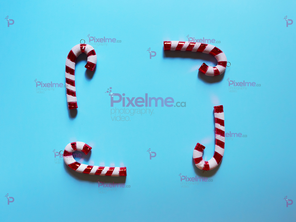 Christmas candy cane drums  at studio above view over a light blue background isolated flatlay