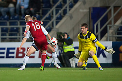 Falkirk's keeper Michael McGovern saves from Nicky Low.<br /> Falkirk 0 v 5 Aberdeen, the third round of the Scottish League Cup.<br /> ©Michael Schofield.