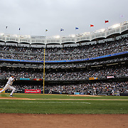 Derek Jeter, New York Yankees, rounds third to score a run in the fifth inning during the New York Yankees V Baltimore Orioles home opening day at Yankee Stadium, The Bronx, New York. 7th April 2014. Photo Tim Clayton