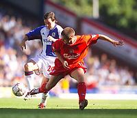 Photo. Jed Wee.<br /> Blackburn Rovers v Liverpool, FA Barclaycard Premiership, Ewood Park, Blackburn. 13/09/2003.<br /> Liverpool's Michael Owen (R) and Blackburn's David Thompson tangle.
