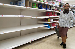 © Licensed to London News Pictures. 21/09/2021. London, UK. A shopper walks past empty shelves of fruit juice in Sainsbury's, north London, Fears of food shortages grow after two of the UK's biggest Carbon Dioxide (CO2) producers halted production last week due to soaring gas prices. UK food producers and supermarkets are warning that shoppers are likely to face food shortage caused by a lack of gas could hit this week. Photo credit: Dinendra Haria/LNP