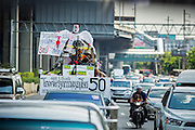 08 MAY 2013 - BANGKOK, THAILAND: A Red Shirt dressed as the Angel of Democracy in a motorcade going to the Thai parliament building. A splinter group of the Red Shirts, Thai supporters of exiled Prime Minister Thaksin Shinawatra, have besieged the Thai Constitutional Court for the last three weeks calling for the resignation of the justices, who have indicated they might oppose a proposed constitutional reform which would grant amnesty to people convicted of political crimes since 2007. This would probably include Thaksin. The justices have refused to step down. Wednesday the protesters moved their protest to the Thai Parliament, which is largely powerless to intervene.   PHOTO BY JACK KURTZ