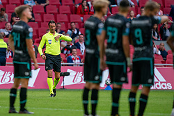 Referee Bas Nijhuis and the VAR in action during eredivisie round 02 between Ajax and RKC at Johan Cruyff Arena on September 20, 2020 in Amsterdam, Netherlands