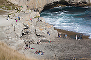 Bank holiday visitors to Dancing Ledge on the Purbeck coast, Dorset, UK.