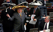 TALLAHASSEE, FL. 5/4/07-Rep. Luis Garcia, D-Miami Beach, center, gets a look from Rep. Greg Evers, R-Baker, right, as he joined by three other sombrero-wearing house members for a resolution commemorating Cinco de Mayo, Friday at the Capitol in Tallahassee. Behind Garcia are Reps. Darren Soto, D-Orlando, left, Eddy Gonzalez, R-Hialeah, and Rep. Michael Scionti, D-Tampa. COLIN HACKLEY PHOTO