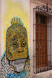 North America, Mexico, Oaxaca Province, Oaxaca, skull mural and wrought-iron window grill, Day of the Dead (Dias de los Muertos) celebration