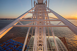 "United States, Washington, Seattle, ""Great Wheel"" ferris wheel, Elliott Bay, and the Olympic Mountains at sunset"