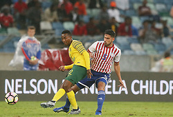20/11/2018-Bafana Bafana attacker Lebogang Maboe tries to make a getaway from Paraguayan Bruno Valdez<br /> Picture: Doctor Ngcobo/African News Agency(ANA)
