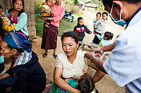siyang Wathaoyang receives  her JE vaccine at the campaign in Khon Kahndone Village, Xieng Khouang province, Laos. Her oldest son died at age 13 from JE, and now the rest of the family are getting their vaccines.