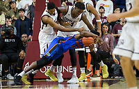 Florida forward Kevarrius Hayes (13) dives for a loose ball against Texas A&M center Tonny Trocha-Morelos (10) and forward Robert Williams (44) during the second half of an NCAA college basketball game Tuesday, Jan. 2, 2018, in College Station, Texas. (AP Photo/Sam Craft)