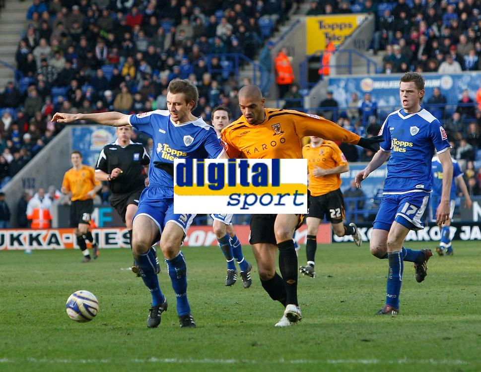 Photo: Steve Bond/Richard Lane Photography. <br />Leicester City v Hull City. Coca Cola Championship. 21/03/2008. Hull sub Caleb Folan (R) takes on Gareth McAuley (L)