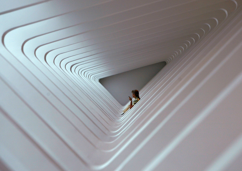 A woman is framed by a series of arches in the Milwaukee Art Museum near the final Harley-Davidson party in downtown Milwaukee August 31, 2003 during an exhibit featuring industrial design in the Santiago Calatrava-designed Quadracci Pavilion. The legendary American motorcycle company celebrated its 100th anniversary over four days.    REUTERS/Rick Wilking