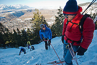 Jackson Hole Mountain Guide Mike Poborsky shows Viktor Marohnic proper rappel techniques while practicing at the summit of Snow King Mountain in early March.
