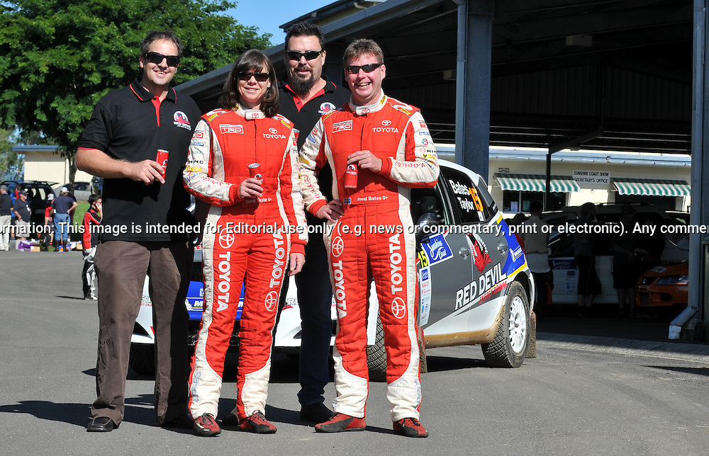 Neal Bates & Coral Tayor with Rod and Shane from Red Devil Energy Drinks .Media Day/Shakedown.Red Devil Energy Drink Rally of Queensland.Nambour Showgrounds, Nambour, Sunshine Coast, Qld.8th of May 2009.(C) Joel Strickland Photographics.Use information: This image is intended for Editorial use only (e.g. news or commentary, print or electronic). Any commercial or promotional use requires additional clearance.