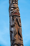 """Gitanyow Totem Poles, on the Kitwanga River in British Columbia, Canada. Listed as a National Historic Site of Canada, Gitanyow (formerly Kitwancool) village is a First Nations reserve community of about 400 Gitxsan people. Posted 1967 BC sign: """"These stately monuments in cedar proclaim the owner's clan status and inherited family traditions, but were never associated with religion. Clan crests portrayed mythical creatures, sometimes in human form, from the legendary history of the clan."""" The word totem derives from the Algonquian word odoodem meaning """"(his) kinship group"""". Gitanyow is on a short side loop off the scenic Stewart–Cassiar Highway (Highway 37, aka Dease Lake Highway), just 24 km north of the junction with Yellowhead Highway (Hwy 16)."""