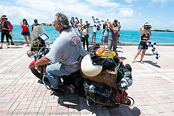 Tim McIntyre riding his 1948 Indian Chief over the finish line of the Cross Country Chase motorcycle endurance run from Sault Sainte Marie, MI to Key West, FL. (for vintage bikes from 1930-1948). The Grand Finish in Key West's Mallory Square after the 110 mile Stage-10 ride from Miami to Key West, FL and after covering 2,368 miles of the Cross Country Chase. Sunday, September 15, 2019. Photography ©2019 Michael Lichter.