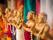 05 JUNE 2015 - KUALA LUMPUR, MALAYSIA:   Hindu deities lined up in Sri Mahamariamman Temple, the oldest functioning and most important Hindu temple in Malaysia. The principal deity in the temple is Mariamman,  a deity that is popularly worshipped by overseas Indians, especially Tamils, because she is looked upon as their protector during the sojourn to foreign lands. Mariamman is a manifestation of the goddess Parvati, an incarnation embodying Mother Earth with all her terrifying force. She is associated with disease and fever and protects her devotees from unholy or demonic events.    PHOTO BY JACK KURTZ