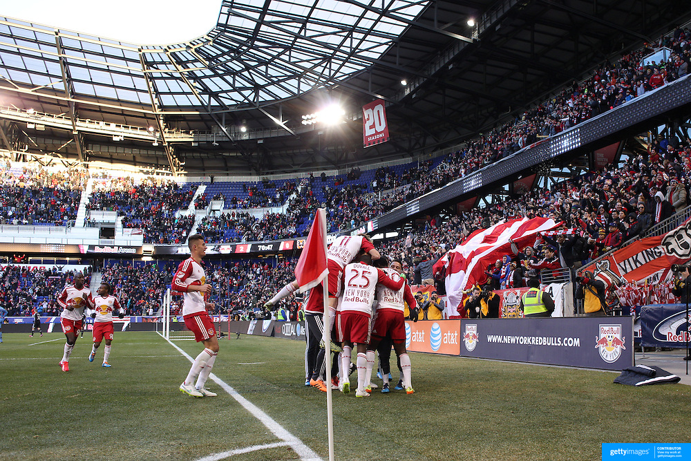 New York Red Bulls players celebrate with Lloyd Sam who scored his sides second goal during the New York Red Bulls Vs D.C. United, Major League Soccer regular season opening match at Red Bull Arena, Harrison, New Jersey. USA. 22nd March 2015. Photo Tim Clayton