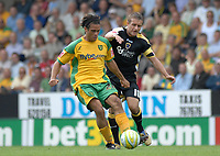 Photo: Ashley Pickering.<br /> Norwich City v Cardiff City. Coca Cola Championship. 01/09/2007.<br /> Cardiff captain Stephen McPhail (R) takes on Darel Russell of Norwich